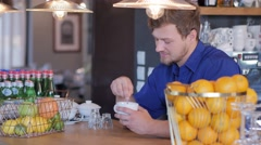 Barista tasting a new type of coffee in his coffee shop Stock Footage