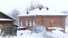 Country Red Brick House With Russian Flag on the Top. Winter Stock Footage