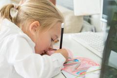 Creativity concept. Little girl drawing Stock Photos