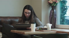 Business woman on lunch break with tablet in cafe or restaurant working - stock footage