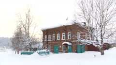 Snow Land. Russian Village School. Red Brick Building. Trees. Wide Shot Stock Footage