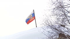 Russian Federation Tricolor Flag Waves on the Hill Covered With Snow Stock Footage