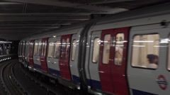 Two london underground tubes passing by Stock Footage