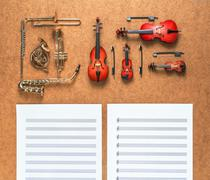 Set of five golden brass wind and four string musical orchestra instruments - stock photo