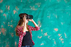 Woman in virtual reality headset enjoying her experience Stock Photos
