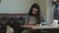 Witer serves womans order in cafe Stock Footage