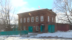 Village Administrative 2 Storey Old Brick House Wtith the Flag on the Top. Stock Footage