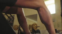 The athlete performs a squat exercise legs close-up - stock footage