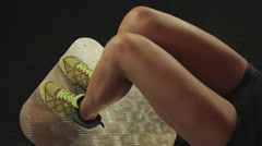 The girl athlete performs a squat exercise legs close-up - stock footage