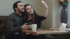 Two young people makeing selfy while in cafe Stock Footage