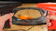 Toy car racing track with orange and black formula 1 cars - stock footage