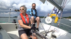 The yacht changes tack. Family team sailing in the Baltic sea. Stock Footage