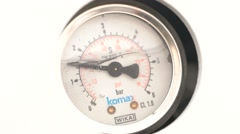 Round pressure gauge with a black arrow. The pressure gauge Stock Footage