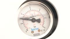 Round pressure gauge with a black arrow. The pressure gauge - stock footage