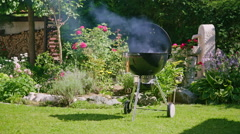 Smoking bbq kettle grill no people Stock Footage