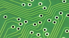 Turning printed circuit board green dolly pan Stock Footage