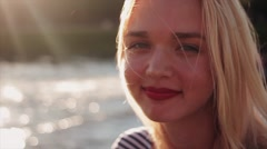Young woman looking at camera and smiling Stock Footage