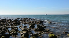 Coastline by boat from the beach stones Stock Footage