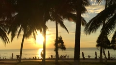 Beach with people have a rest and sport training at the morning sea. Stock Footage