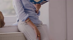 Creative businesswoman reading a book in a modern office Stock Footage