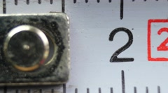 Close-up of a measurement tapeline, slider shot  - stock footage