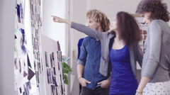 Creative business woman brainstorming with her team with inspiration boards Stock Footage