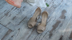 Close up Bride Wearing Shoes With Heels on the Floor Stock Footage