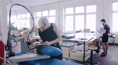 Fashion designer ironing a fabric her studio in her studio Stock Footage
