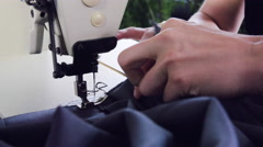 Fashion designer stitching fabric on sewing machine in her studio Stock Footage