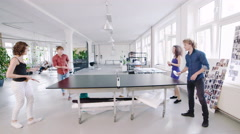Young Business Executives playing ping pong Stock Footage
