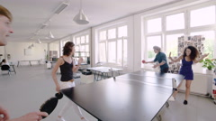 Creative business colleagues playing ping pong in a modern office Stock Footage