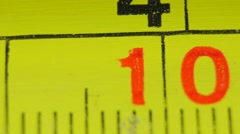 Close-up of a measurement tapeline, slider shot  Stock Footage