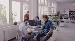 Creative business team at their workstations in a modern office Stock Footage