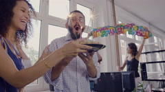 Creative businessman blowing out candles at birthday celebration Stock Footage