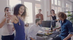 Creative business team toasting glasses of champagne in a modern office Stock Footage