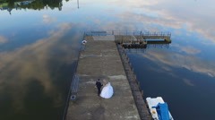 The bride and groom running through the marina, shooting with air quadrocopters Stock Footage
