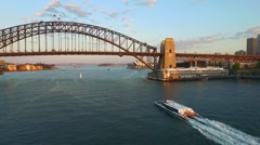 Aerial footage of Sydney Harbour Bridge with Ferry Reveal Stock Footage