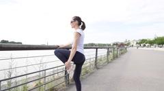 Runner woman exercising in town, riverside - stock footage