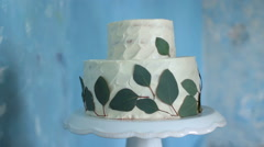 White Cake Fine Art on the Table. Fresh Leaves. Stock Footage