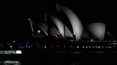 Ferry Drive By Sydney Opera House at night Stock Footage