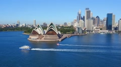 Ferry drives past Sydney Opera House Aerial Stock Footage