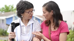 Senior disabled woman and carer spending time together Stock Footage