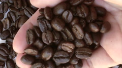 Hand holding coffee grains Stock Footage