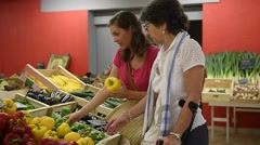 Senior woman going to grocery store with help of carer Stock Footage