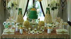 Sweet buffet birthday party. gold sweet buffet Stock Footage