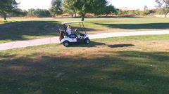 4k aerial view pan 360 around golf kart Stock Footage