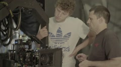 Behind the scenes filming. Camera and cameraman on set Stock Footage
