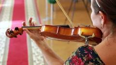 Portrait of woman Caucasian Violinist closeup. Stock Footage