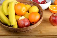 fresh fruits on wooden table. Healthy eating concept - stock photo