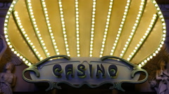 Zoom Out - Lighted Casino Entrance Sign - Las Vegas Stock Footage